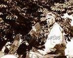 1940 Harley Davidson Motorcycle and Rider Photo 2