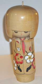 This is a Vintage 6 3/4 Traditional Japanese Wooden Kokeshi Doll.