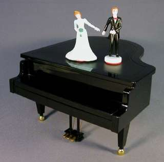 MUSIC BOX GRAND PLAYER PIANO WITH DANCING COUPLE ON TOP EVEN KEYS MOVE