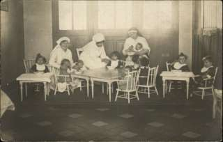 ORPHANAGE ?? Nuns Tend to Babies and Little Children c1910 Real Photo