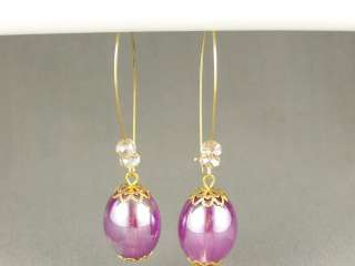 Gold tone oval kidney wire hoop dangle earrings 2 7/8 long iridescent