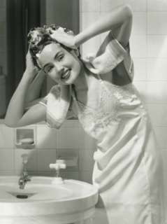 Portrait of Young Woman Washing Hair in Bathroom Photographic Print by
