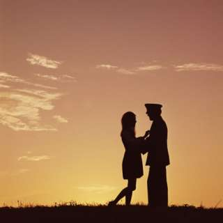 Silhouette of Army Officer and Woman at Sunset Photographic Print by