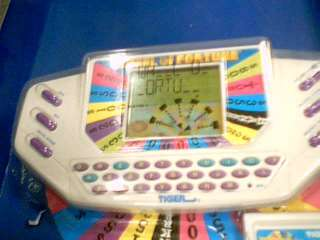 1998 TIGER ELECTRONICS WHEEL OF FORTUNE W/#9 CART ~USED