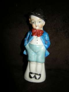 Adorable Dapper miniature boy doll in top hat and bow