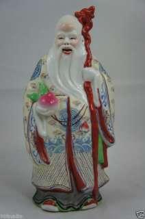 VINTAGE CHINESE PORCELAIN FIGURINE MAN W/FRUIT 8 1/4